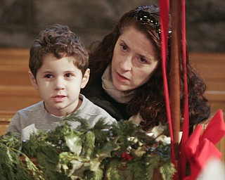 Walter Angell, 5, and his mother, Kate Angell of Pittsburgh, formerly of Youngstown, were part of a capacity crowd at Sunday's 50th anniversary observance of the Boar's Head and Yule Log Festival at St. John's Episcopal Church, a 110-year-old Norman Gothic edifice in Youngstown.
