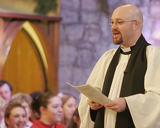 Rev. Bradley Pace, rector of St John's Episcopal Church in Youngstown speaks at the Boar's Head and Yule Log Festival. Sunday marked the 50th anniversary festival, which is held annually on the second Sunday in January.