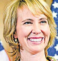 In this photo taken Wednesday, Jan. 5, 2011, Rep. Gabrielle Giffords, D-Ariz., takes part in a reenactment of her swearing-in, on Capitol Hill in Washington. Rep. Gabrielle Giffords of Arizona was shot in the head Saturday, Jan. 8, 2011 when an assailant opened fire outside a grocery store during a meeting with constituents, killing at least five people and wounding several others in a rampage that rattled the nation.