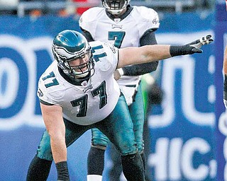 Philadelphia Eagles center Mike McGlynn and quarterback Michael Vick in the first half of an NFL football game against the Chicago Bears in Chicago, Sunday, Nov. 28, 2010.