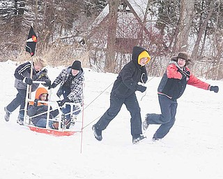 Boy Scouts from Troop 46 in Boardman head for the finish line in sled races. Saturday's derby featured competition in outdoor activities testing Boy Scouts' skills.