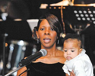 Sonja Williams, wife of Mayor Jay Williams, and their son Ethan welcome the attendees of the Mayor's community Celebration at Stambaugh Auditorium on Saturday.