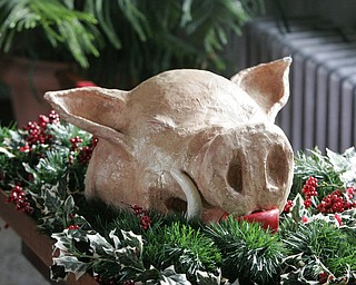 The boar's head, symbolizing the triumph of Christ over evil, is carried into St. John's Episcopal Church, 323 Wick Ave., Sunday to mark the 50th anniversary of the Youngstown church's Boar's Head and Yule Log Festival, which is held annually on the second Sunday in January.