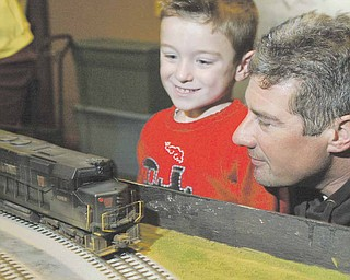 Michael Katula and his son Michael 4, check out model trains during model railroad flea market Sunday at McMenemys in Niles. They are from Struthers.