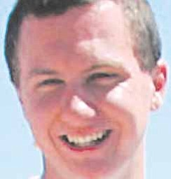 This March 2010 photo shows a man identified as Jared L. Loughner at the 2010 Tucson Festival of Books in Tucson, Ariz. The Arizona Daily Star, a festival sponsor, confirmed from their records that the subject's address matches one under investigation by police after a shooting in Tucson that left U.S. Rep. Gabrielle Giffords wounded and at least five others dead. Police say a suspect is in custody, and he was identified by people familiar with the investigation as Jared Loughner, 22, of Tucson.