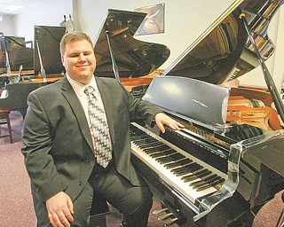 Tom Solich, owner of Solich Piano and Music Co. in Boardman, has been blind all his life and learned to play through a blind tutor.