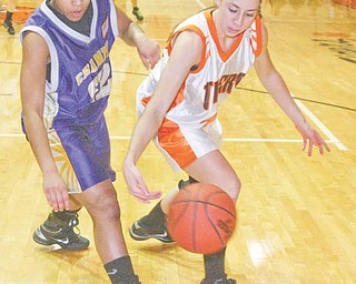 Champion's Briana Lewis (22)  and  Jenn Bjelac (14) go for the ball during theirr game Monday night in Newton Falls.