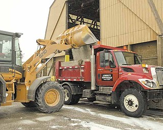 A Liberty Township snow plow at the township garage on Gypsy Lane is filled with salt in anticipation of snowy weather. Maintenance of township roads, including snow and ice removal, is another of a township's mandated duties.