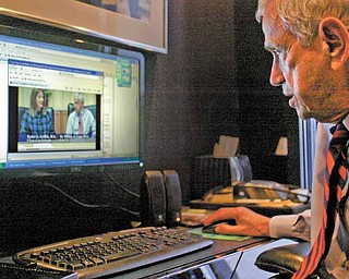 Dr. William H. Lippy, renowned ear doctor from Warren, looks over one of the videos heÕs made that deals with hearing loss and hearing aids. The doctor has five videos available online. The four- to five-minute programs are geared toward the layman and covers a variety of topics on hearing loss and hearing aids. To access the videos, go to www.lippygroup.com and click on hearing-aid videos.