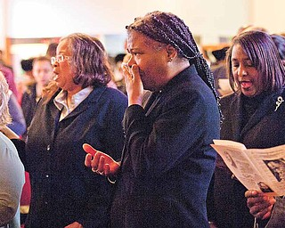 Pastor Sylvia Jennings of Oak Missionary Baptist Church becomes emotional during a service held Sunday at Tabernacle Baptist Church to honor Dr. Martin Luther King Jr. The service featured a talk by Bishop Durant K. Harvin III of Baltimore.