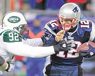 New York Jets defensive end Shaun Ellis (92) sacks New England Patriots quarterback Tom Brady (12) during the first half of an NFL divisional playoff football game in Foxborough, Mass., Sunday, Jan. 16, 2011.