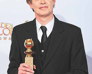 "Steve Buscemi holds up his award for Best Performance by an Actor in a Television Series - Drama for his role in ""Boardwalk Empire,"" at the Golden Globe Awards Sunday, Jan. 16, 2011, in Beverly Hills, Calif."