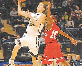 McDonald Blue Devil Patrick Kunkel goes for a lay up while being defended by Columbiana Clipper Mardell Halas.