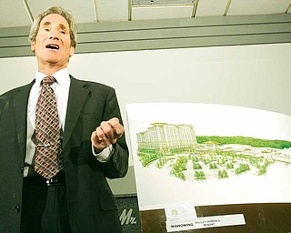 A proposed $300 million complex in the Mahoning Valley would include a horse racetrack, a golf course, restaurants and stores. Bradford Pressman, one of the developers of what would be called Mahoning Valley Downs and Resorts, explains the project to reporters Tuesday at Mr. Anthony's in Boardman.