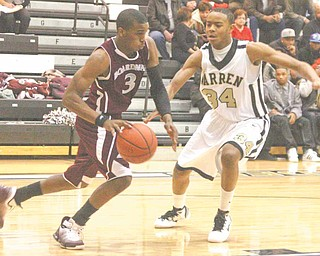 Trae Robinson (3) tries to get past Warren Harding's Tre Brown (34) during their game Tuesday night.