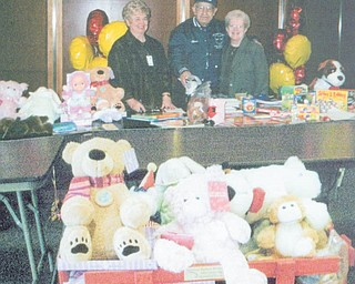 Gifts rolled into hospital: Mill Creek Chapter of the American Business Women's Association donated toys, which were loaded into a wagon donated by Charles Billock and delivered to children at Akron Children's Hospital in December by Judy Codespote, Joyce Billock and Kathy Anderson. An engraved plaque was attached to the wagon in memory of Susan Billock, a former member who lost her battle with cancer. Shown as they prepared the gifts for giving were, from left, Sue Heher, hospital volunteer; Charles Billock, Susan's father, who donated the wagon; and Codespote, chapter president.