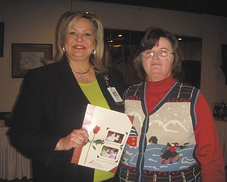 Dispensing information: Liz McGarry, director of development for Hospice of the Valley, presented information about the facility at a recent meeting of the Girard Junior Women's Club. After her talk, McGarry, at left, shared additional information with Roberta Lawrentz, club president. The next meeting will be at 6:30 p.m. Feb. 10 at the home of Virginia Cochran on Liberty Street in Girard, where Cindy of Cindy's Health and Vitality will be the speaker. All Girard area women are invited to join the organization. For more information contact the club president.