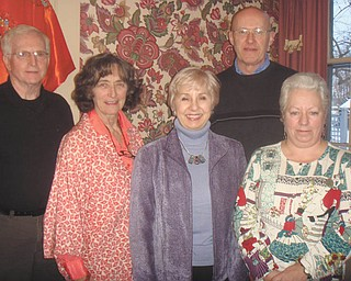 According to the plan: The Upton Association has many ambitious plans for 2011, including the improvement of the Upton House on Mahoning Avenue in Warren and the Women's Park in Warren, and adding quality to the community. Among those interested in making the plans a reality are members of the executive board, from left, Tom Barnes and Judy Sheridan, who are returning to the board as secretary and treasurer; Carol Olson, president; Ken Conklin, vice president; and Sue Stoddard, past president.