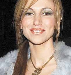 "In this February 9, 2003 file photograph, Debbie Gibson attends the Luca Luca ready-to-wear Fall 2003 fashion show as part of the Mercedes-Benz fashion week in New York. Along with her role in the Syfy Network's ""Mega Python vs. Gatoroid,"" Gibson is getting ready to mount a musical comeback this year."