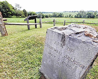 In this Aug. 7, 2009 file photo, a gravestone marker on the spot where the arm of General Stonewall Jackson is buried is near the Ellwood house in Locust Grove, Va. Civil War history will play out in a rural Virginia courtroom this week when Wal-Mart Stores Inc. defends a planned store near the hallowed site where Robert E. Lee and Ulysses S. Grant first met on a battlefield in 1864.