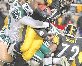 Pittsburgh Steelers running back Rashard Mendenhall (34) surges for a 1-yard touchdown in the grasp of New York Jets linebacker Bart Scott (57) during the first half of the AFC Championship NFL football game in Pittsburgh, Sunday, Jan. 23, 2011.
