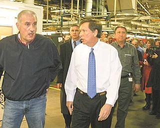 Finishing a brief tour of the Lordstown General Motors assembly plant, Gov. John Kasich, right, talks with Jim Graham, president of the United Auto Workers Local 1112. Kasich chose the auto facility as the location for his first official visit in Northeast Ohio as governor.