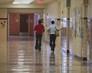 Students walk the halls on their way to class in Chaney High School. Doors open at 7:30 a.m. as students eat a school-provided breakfast. The first class begins at 8 a.m.