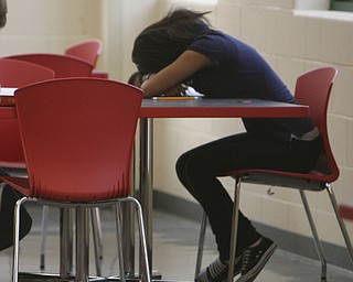 A student rests on a table at Youngstown's Chaney High School.