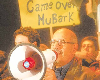 Egyptian Nobel Peace laureate and democracy advocate Mohamed ElBaradei addresses the crowd at Tahrir Square in Cairo, Sunday Jan.30, 2011.