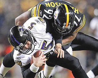 Baltimore Ravens quarterback Joe Flacco (5) is sacked by Pittsburgh Steelers linebacker James Harrison (92) during the second half of an NFL divisional football game in Pittsburgh, Saturday, Jan. 15, 2011.