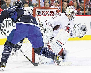 Team Lidstrom's Danny Briere, left, of the Philadelphia Flyers, scores on Team Staal's Carey Price, of the Montreal Canadiens, during the second period of hockey's NHL All-Star Game on Sunday, Jan. 30, 2011, in Raleigh, N.C.