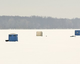 ROBERT K. YOSAY | THE VINDICATOR..Ice Fishing is cool - The right spot seems to attrack several fisherman  as the popular winter sport adds color to a dreary winter day... Ó--30-..
