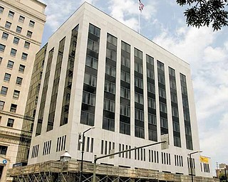 It will be another five to six months before scaffolding around the PNC Bank Building in downtown Youngstown is removed. The owners of the building want to install 54 metal strips to the building to stabilize granite panels on its exterior.
