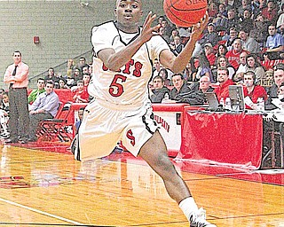 STRUTHERS - POLAND - Struthers' Ja'Meire Brown (5) makes a play on the ball Wednesday night.