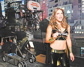 "In this photo taken Monday, Dec. 6, 2010, GoDaddy.com Girl Jillian Michaels, Fitness trainer & ""Biggest Loser"" celebrity, is seen during the filming production of the 2010 Super Bowl television commercial for ""GoDaddy.com"" at the Delfino Studios in Sylmar, Calif. While the Super Bowl is the biggest gambling event of the year, for many advertisers, buying time in the game is a wager that almost always pays off."