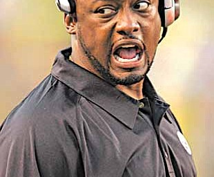 Pittsburgh Steelers head coach Mike Tomlin congratulates players on his special teams after a first quarter punt return against the Green Bay Packers during pre-season football action in Pittsburgh, in this Aug. 11, 2007 file photo.