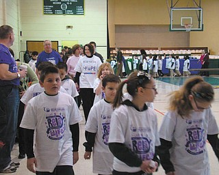 Walking to fight cancer: At St. Patrick School in Hubbard, students, faculty and families continued their tradition of helping others as they kicked off their annual Catholic Schools Week celebration this week. The school started the week with the annual Relay for Life for the American Cancer Society. The Ealy family coordinated this year's event. The opening ceremonies speaker was Barbara Wheeler, grandmother of first-grader Jayden Johnston, who escorted her to the podium. Mrs. Wheeler is an 18-month cancer survivor. The school raised $1,120 for the American Cancer Society.