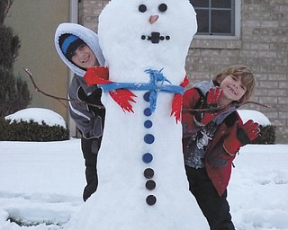 One more look at Ivan and Alec Bosnjak and their snowman. Photo sent in by their parents, Andrea and Ivan Bosnjak, all of Boardman.
