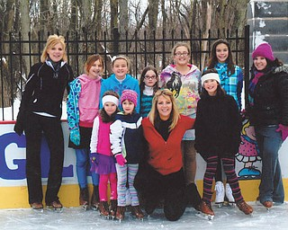 Recent skaters at the ice rink built by Rick and Laura Glass on their property in McDonald are, front from left, Maria, Gianna, Laura and Sophia, all of McDonald, and, back from left, Kim of Girard, Alesha and Bethany of McDonald, Chloe of Hartford, Olivia and Allison of McDonald and Kayla of Girard.