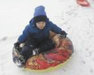 Timmy, 4, of Poland, enjoys playing on a new sled. Photo submitted by Gary Kerr.