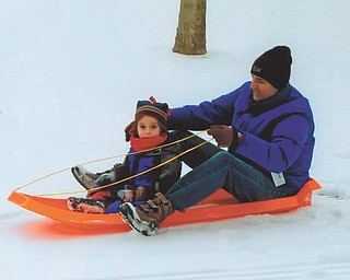While visiting for Christmas, 3 1/2-year-old Oscar Wolf Calipari and his dad, Matthew, found perfect sledding conditions in the backyard at the home of his grandparents, Brian and Kathy Wolf of Liberty.