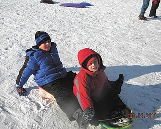 Matthew Ranno and his friend Nick LaPlante, both 8, of Poland find sled riding fun at Mill Creek Park.