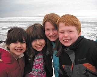 Cousins Erin and Emily Jackson of Boardman and Andrea and Anthony Zuccaro of Kingsville, Ohio, pose in front of frozen Lake Erie at Lake Shore Park in Ashtabula. They are the children of Lisa and Sam Jackson and Tony and Melissa Zuccaro. Photo submitted by grandparents Emil and Ann Bobby of Struthers.