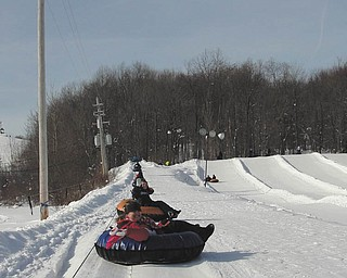 Now that is totally tubular! Samantha and Lindsay Cave from Girard ride their snow tubes on the hill at Alpine Valley Ski Resort in Chesterland, Ohio. Photo sent in by Michele Liggett of Lowellville.