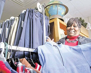 Linda Hoey, parent liaison for the Youngstown schools' Parent Pathways program, sorts through donated clothing that the program collects for students. The program aims to help families with school-related issues.