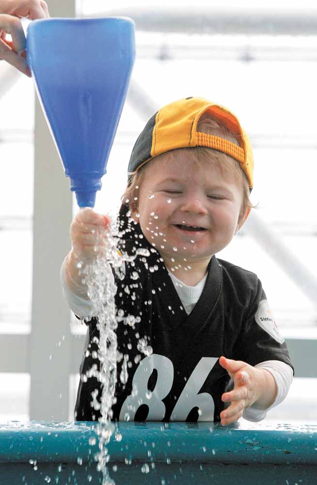 18 month-old Lucas Ahern, of Allison Park, Pa., plays at the water table in the Children's Museum of Pittsburgh as part of a kid's pep rally for the Pittsburgh Steelers, Saturday, Feb. 5, 2011 in Pittsburgh.