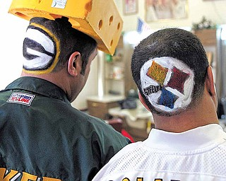 Green Bay Packer fan Mike Coconate,l eft, of Ahwatukee Foothills, and his brother-in-law Pittsburg Steeler fan Howard Davis, right, of Mesa, show off their teams shaved into their hair at Papa Joe's Barbershop in Chandler, Ariz., Friday, Feb. 4, 2011. The Packers and Steelers will face each other in the NFL's Super Bowl XLV football game Sunday, Feb. 6 at Cowboys Stadium in Arlington, Texas.