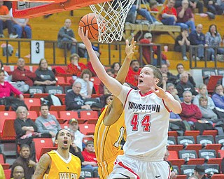 YSU's Vytas Sulskis floats past Valparaiso's Crusader Howard Little to score two points.
