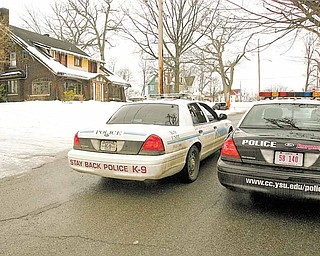 YSU police and Youngstown Police watch over the scene at Indiana Ave - Authorities in northeast Ohio say a shooting at a fraternity house just north of the Youngstown State University campus killed one student and injured 11 people, including six students.