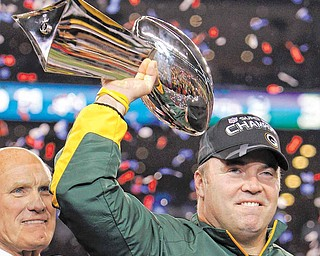 Green Bay Packers head coach Mike McCarthy holds the Vince Lombardi Trophy after the Packers' 31-25 win over the Pittsburgh Steelers in the NFL Super Bowl XLV football game Sunday, Feb. 6, 2011, in Arlington, Texas.